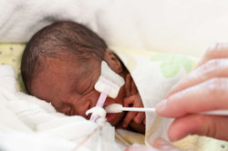 intubated baby getting mouth care