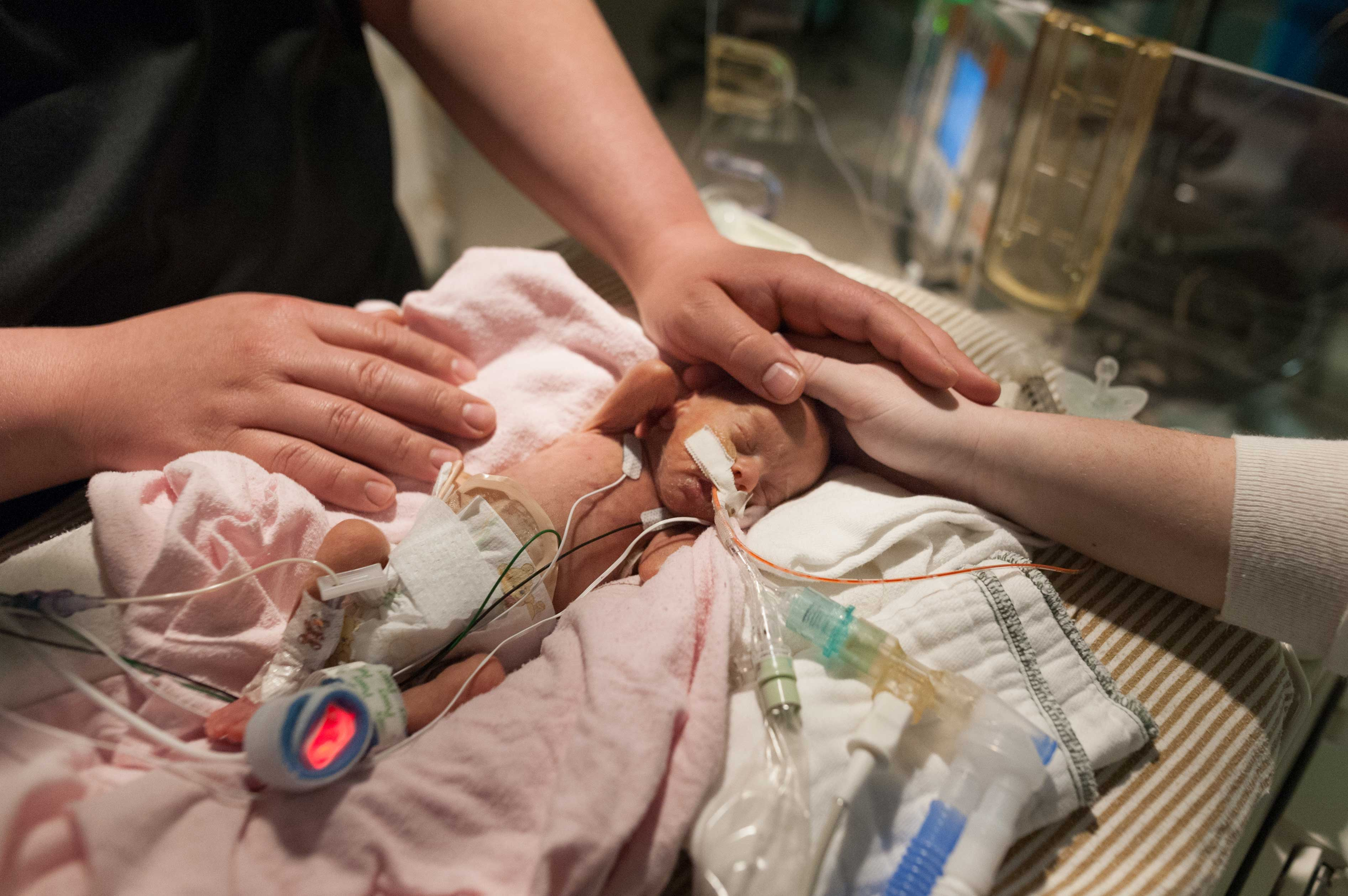 "premature baby ""held"" in containment"