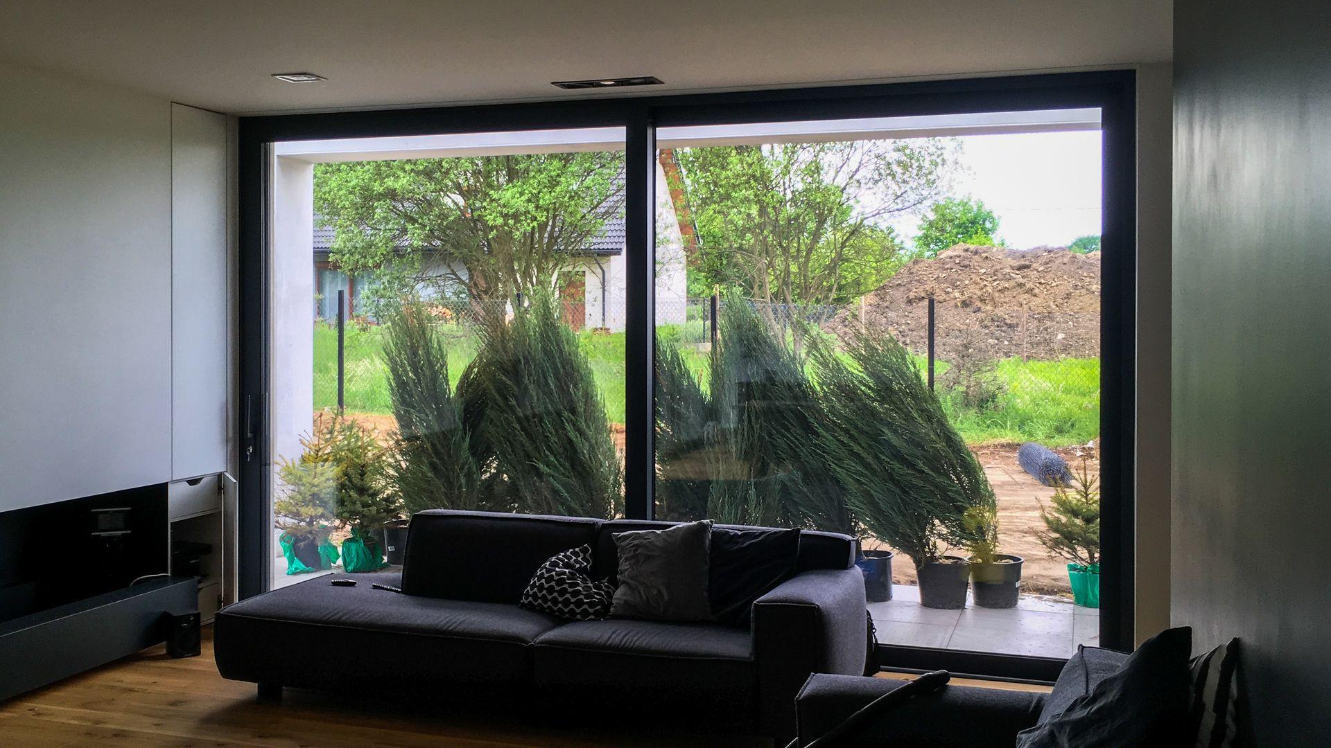 okno tarasowe przesuwne jasne ciche ciepłe nowoczesne wnętrze producent oknowent