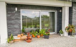 drzwi przesuwne okno tarasowe aluminium do domu mieszkalnego producent aluminium oknowent