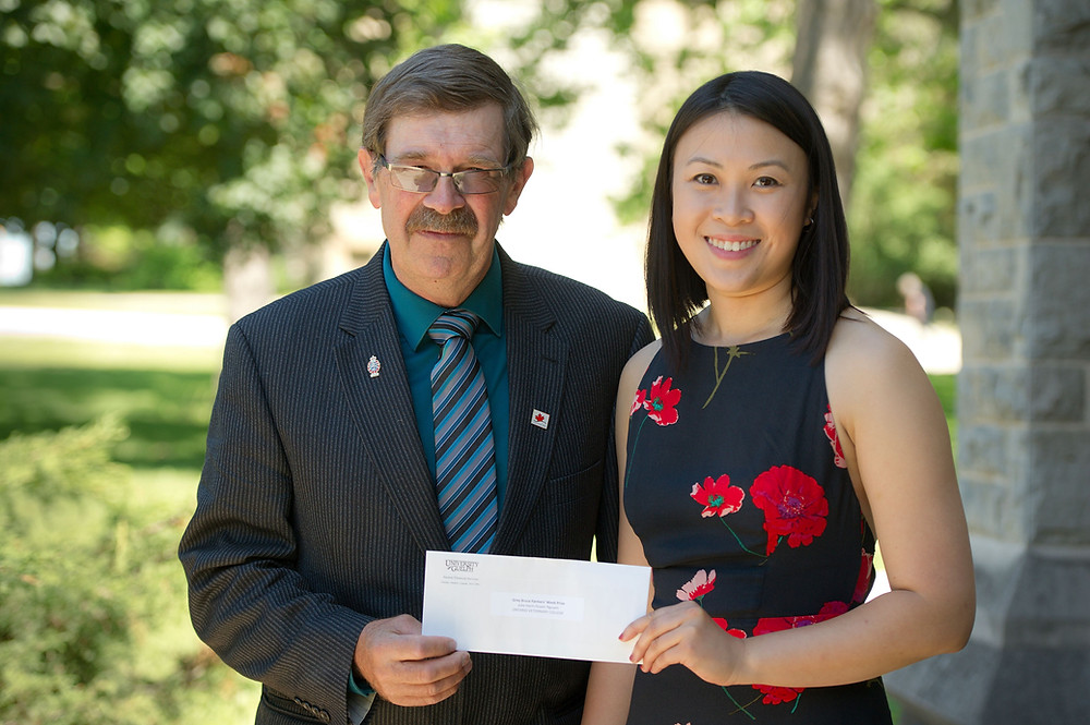 Dr. Julia Nguyen is presented the 2018 Grey Bruce Farmers' Week award by  Bill Herron. The award recognizes the recipient's past accomplishments and encourages future contributions to rural communities in Grey Bruce.