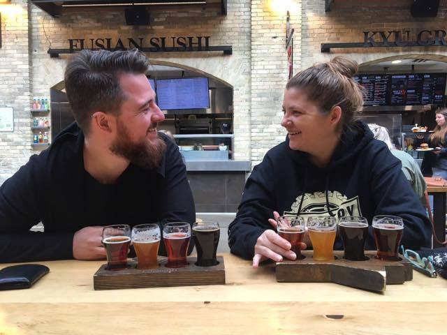 Melanie and Bart tasting craft beer at The Forks in Winnipeg.