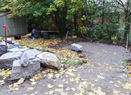 Armour stones waiting for use in retaining wall.