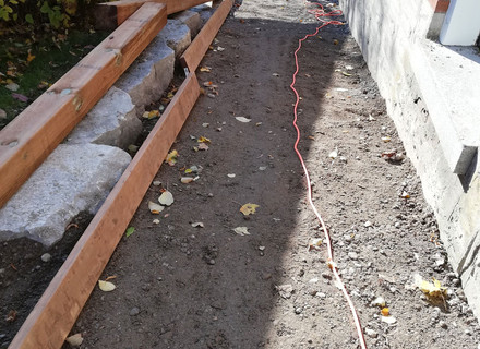 Pavers removed, walkway levelled.jpg