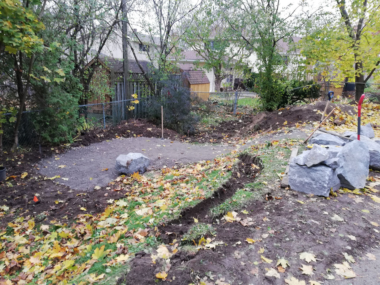 overview of work, patio area below, beginning to prepare retaining wall.