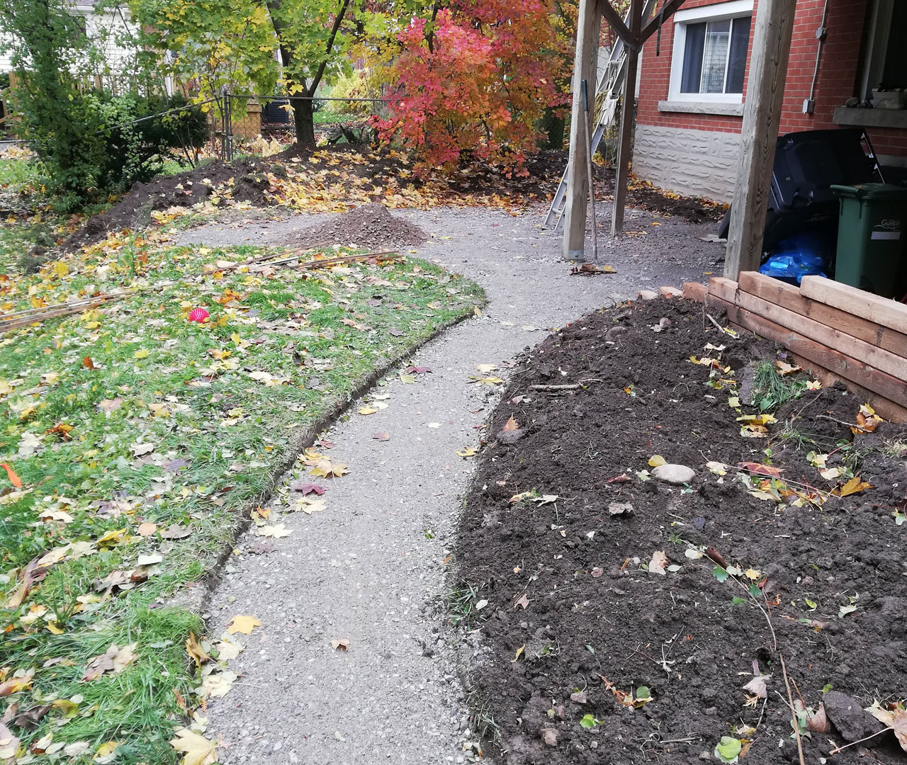 Concrete poured in dug-out back path