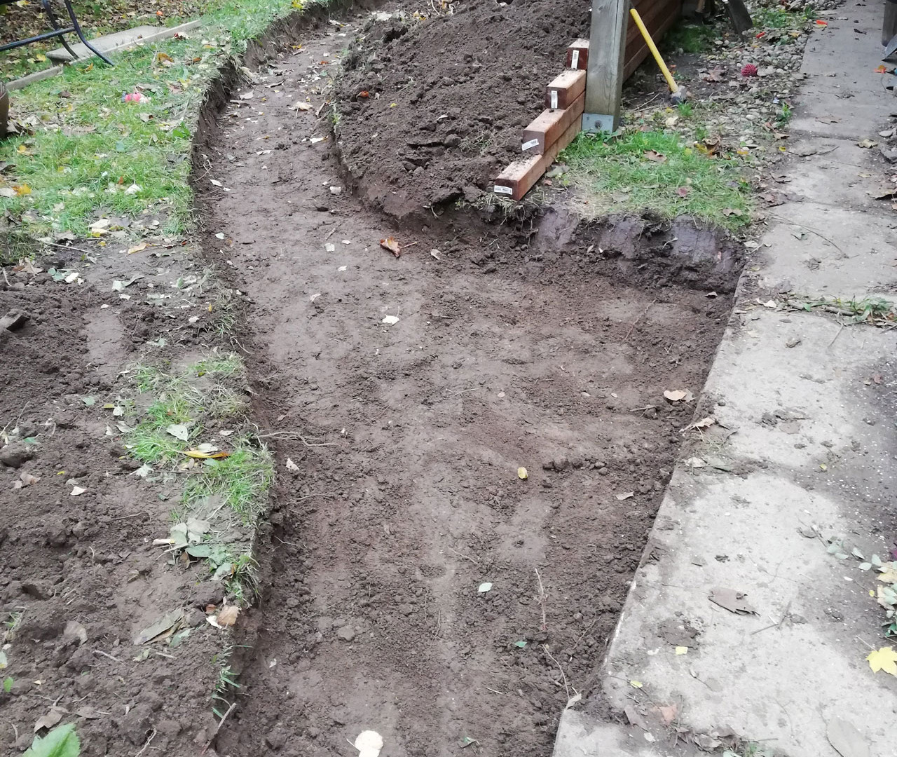 Back path dug out and ready for concrete and hardscaping