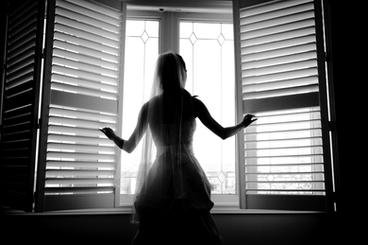 Bride by the window silloutte