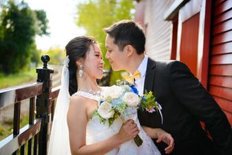 Groom kissing bride smile