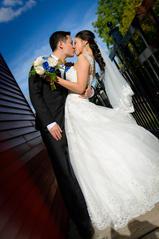 Groom kissng bride