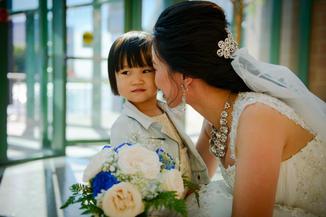 Bride kiss children