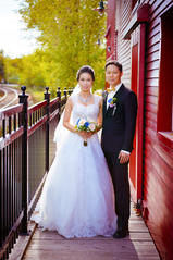 Bride and groom against a wall