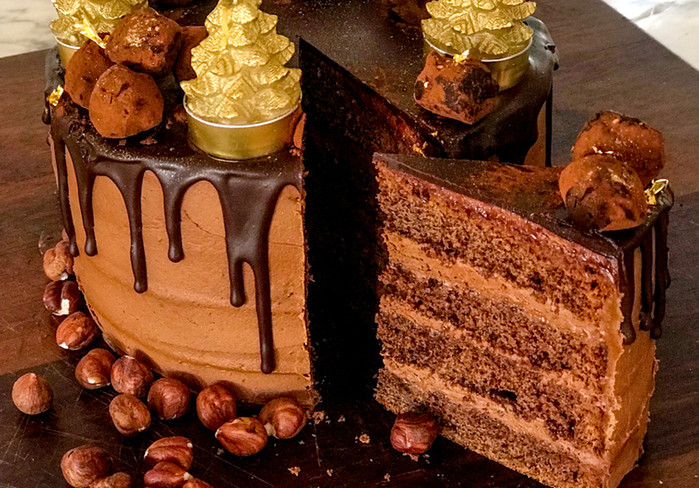 Chocolate, coffee liqueur layer cake with chocolate buttercream & hazelnut truffles