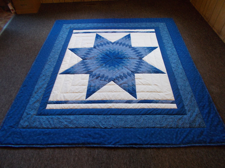 "Royal Blue radiant star Quilt. Queen size. 86"" x 96""."