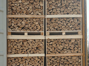 Kiln dried firewood in wooden crates.jpg