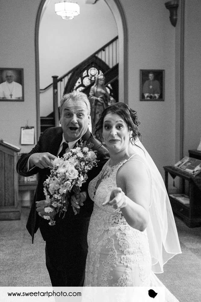 bride with her father and the bride's bouquet