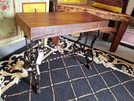 Reimagined wrought iron base and antique barnwood.  Rustic bench, etc.