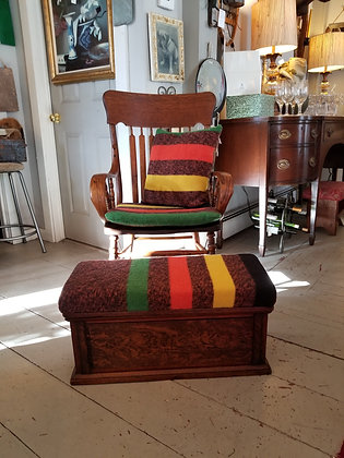 Tiger oak chair with brown Hudson bay style cushion and ottoman.