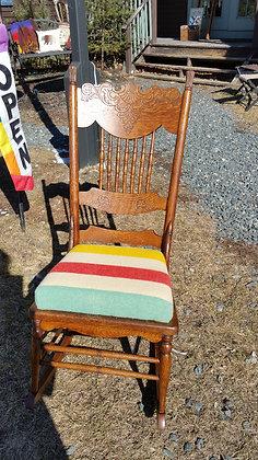 Antique oak rocker with hudson bay cushion.