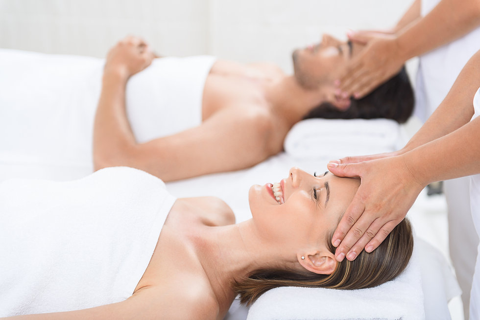 Happy couple getting massage at spa.jpg