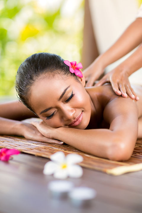 young woman having massage outside in tr