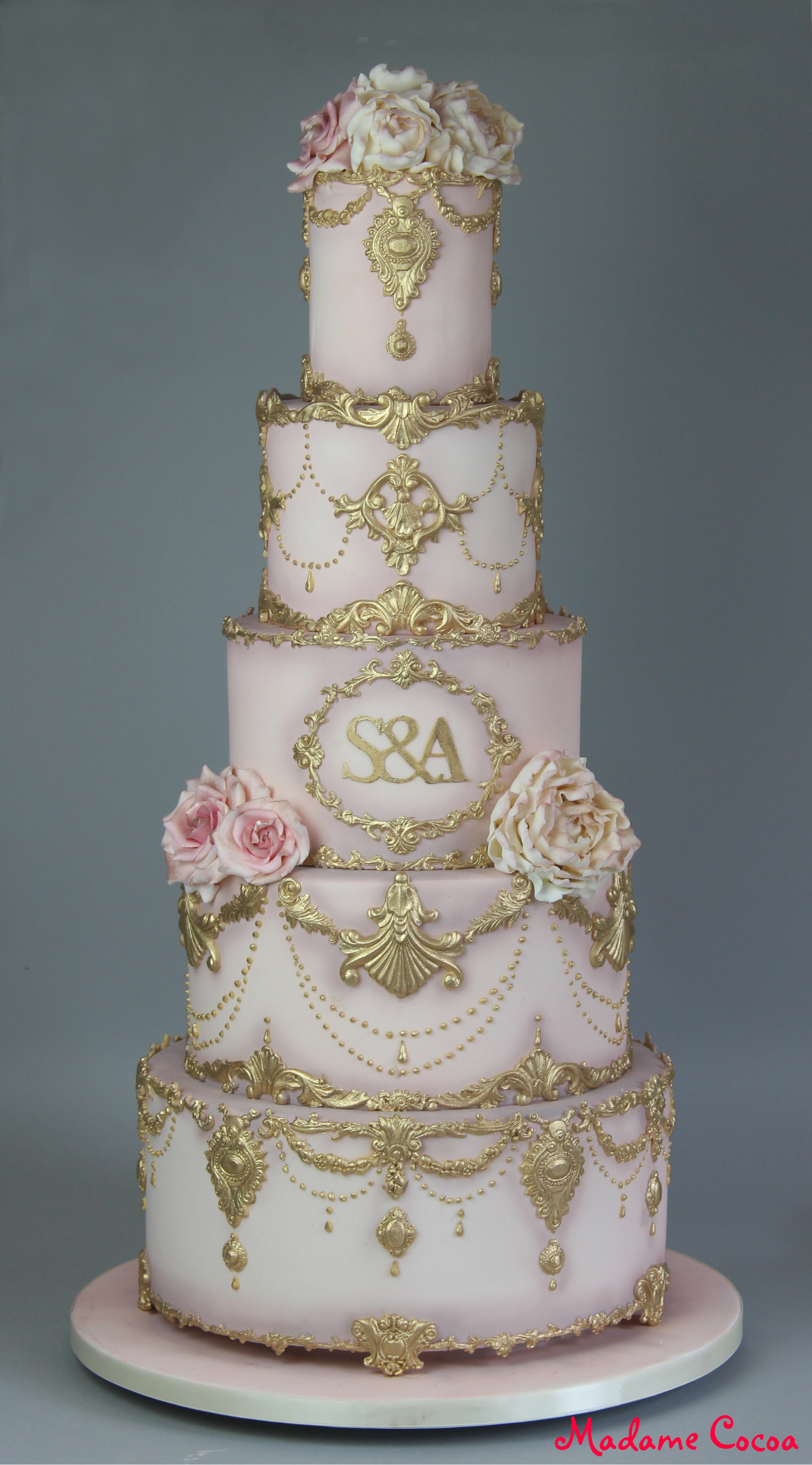 Gold/blush pink ornate wedding cake
