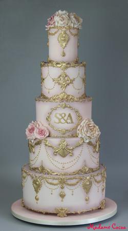 Gold/blush pink ornate wedding cake