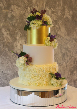 Buttercream and gold leaf wedding ca