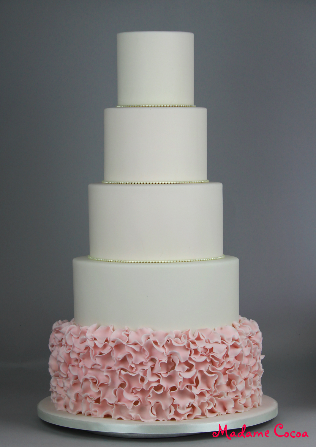 5 tier pink ruffles wedding cake
