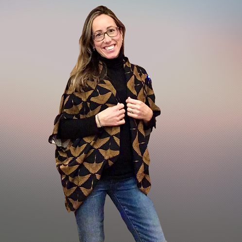model wearing a bronze cranes kimono style top layered with a long sleeve top