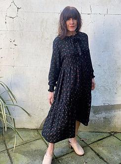 model wearing a midi print dress