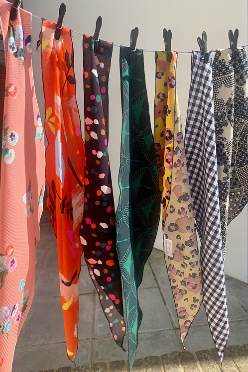 a variety of headscarves hanging on a washing line