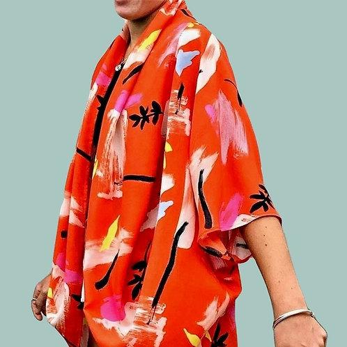 side on view of bright print kimono style top