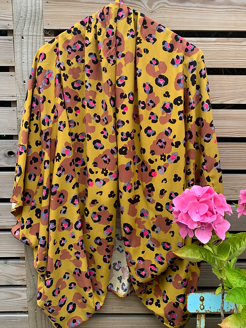 Leopard print viscose fabric kimono style top on a hanger