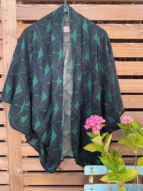 green cranes viscose print fabric kimono style top on a hanger