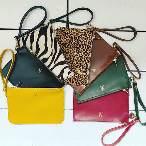 a selection of leather clutch wristlet bags
