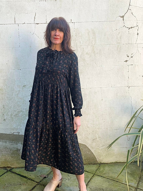 Model wearing tiered print midi dress