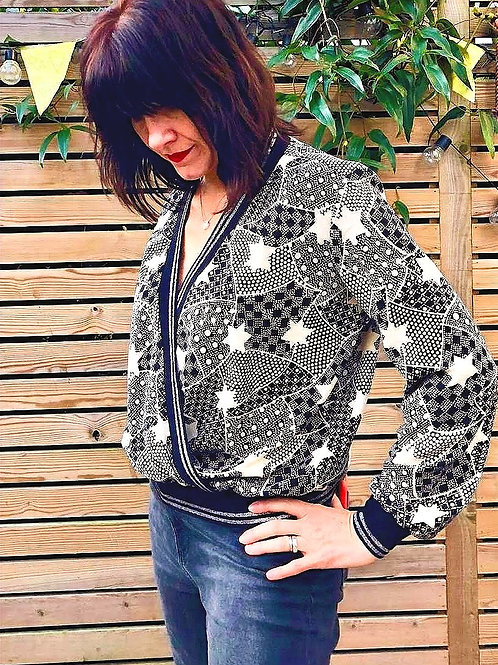 Model wearing monochrome star crossover top with ribbing