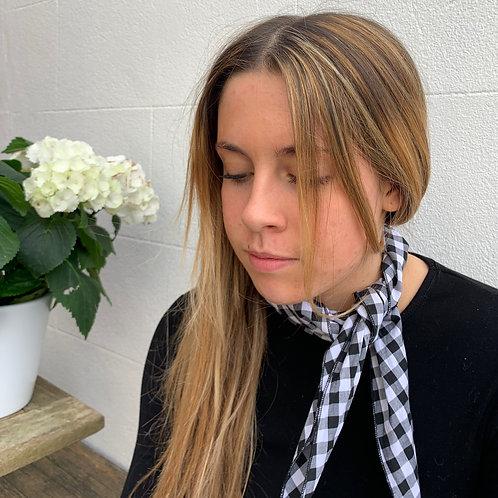 girl wearing gingham neckerchief