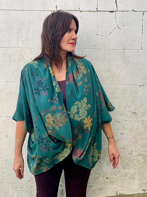Model wearing floral and koi carp print kimono in teal colour