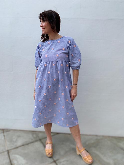 model wearing midid stripe dress with pockets