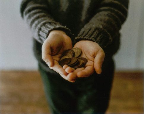 hands holding coins.jpg