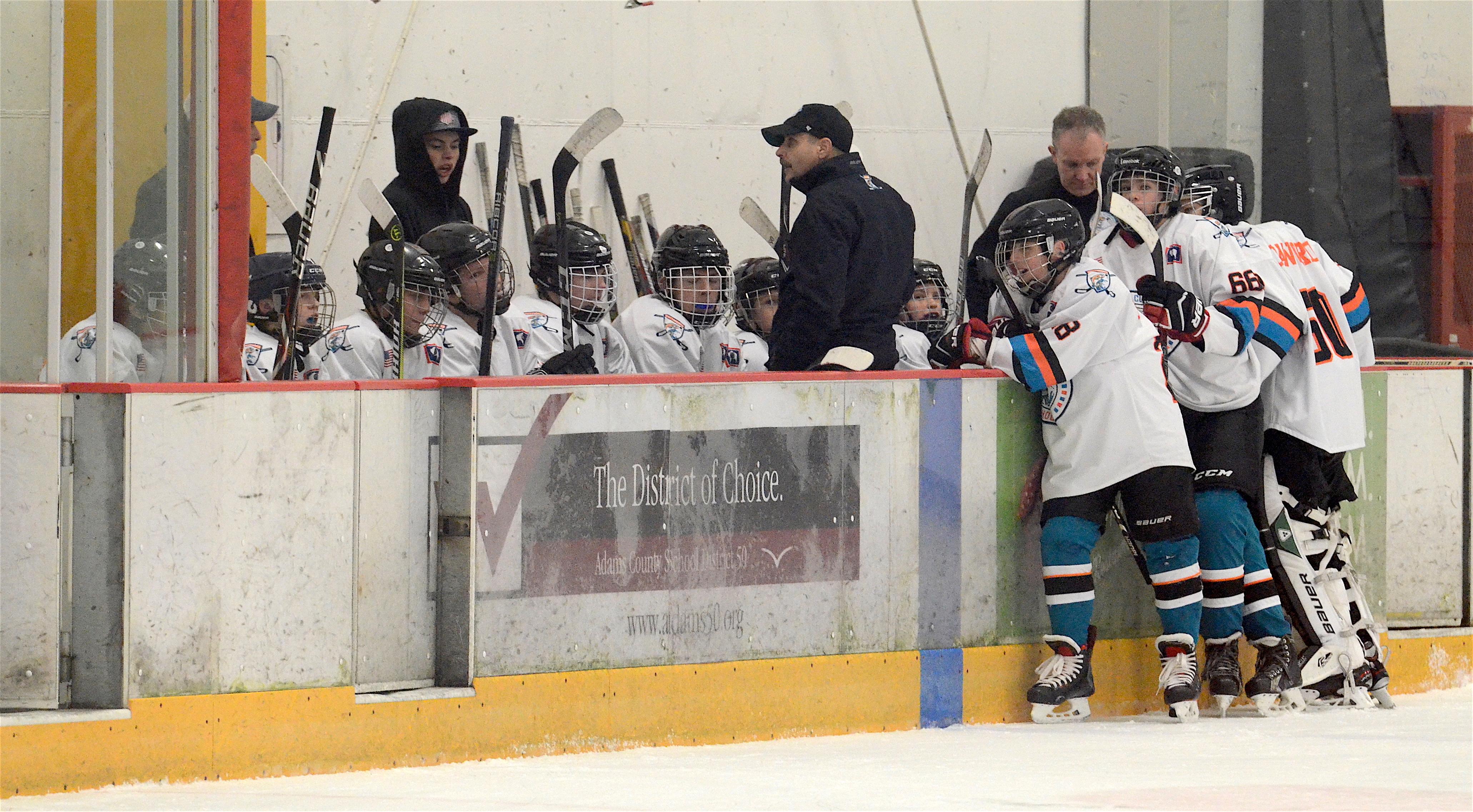 Coach Scheuber and 14U Team