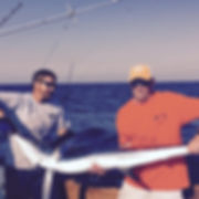 Marlin brought aboard on the Longfin