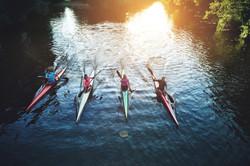 bigstock-Team-Of-Rowing-People-102154052