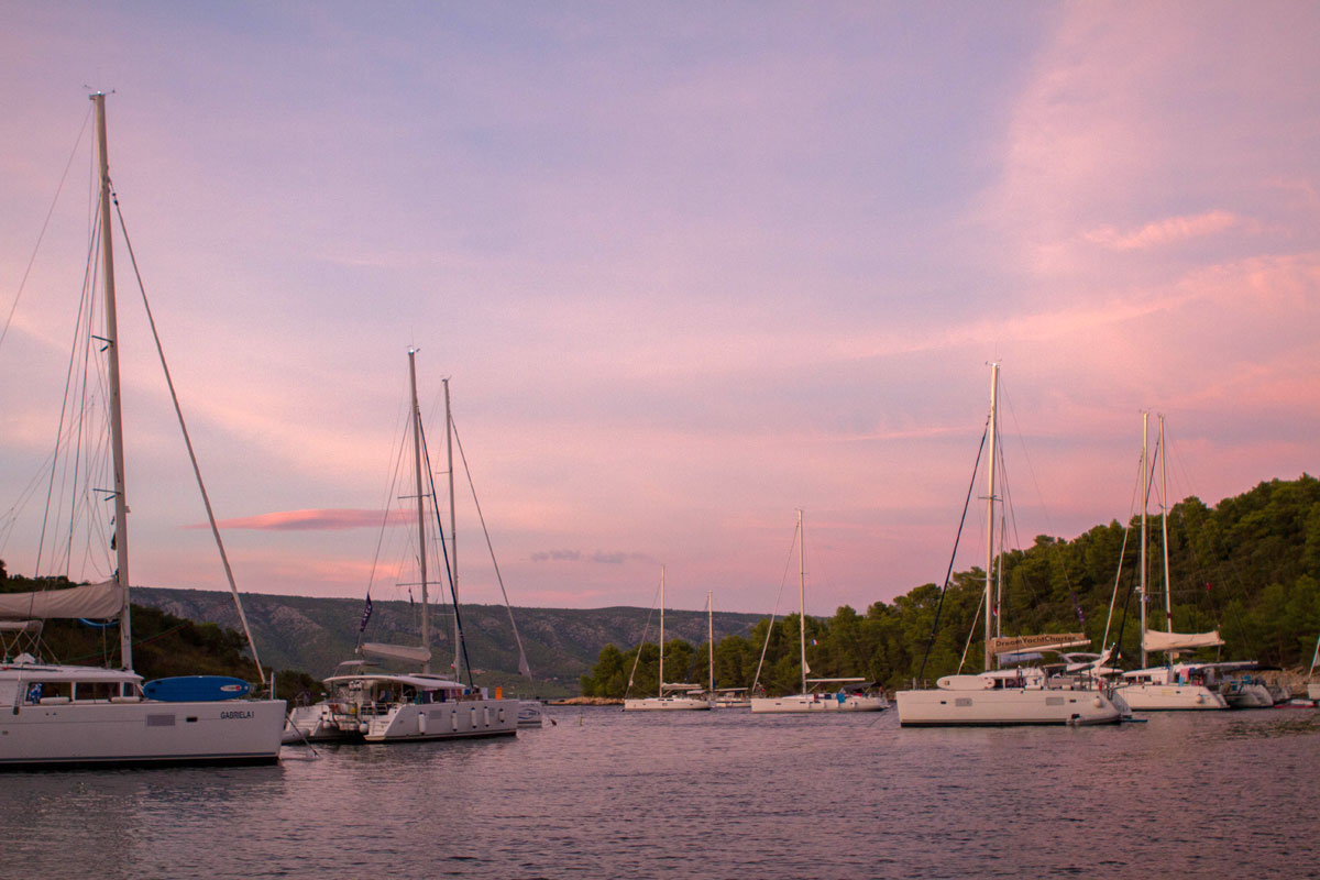 Catamarans-at-dusk_sailing-Dalmatia-Coas