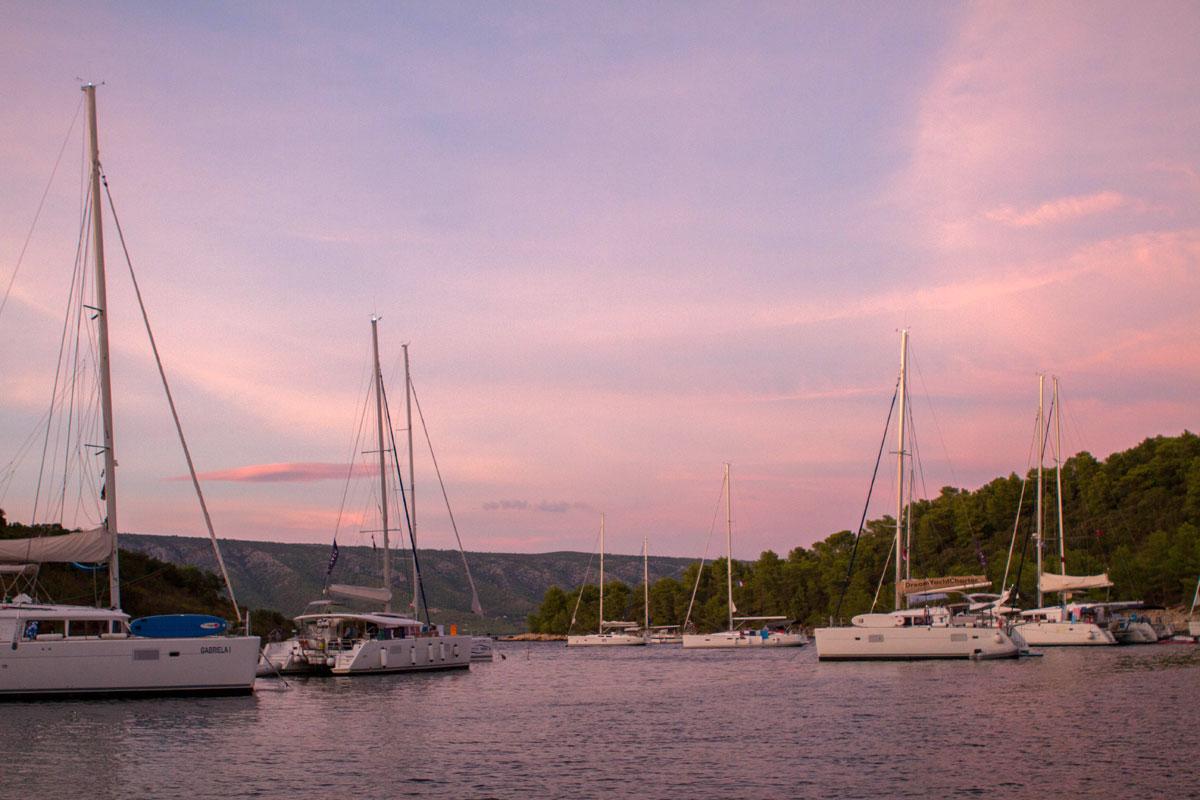 Catamarans-at-dusk_sailing-Dalmatia-Coas