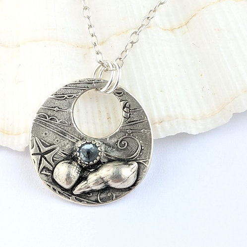 Sustainable Silver Shoreline Pendant necklace with ethically sourced Blue Topaz