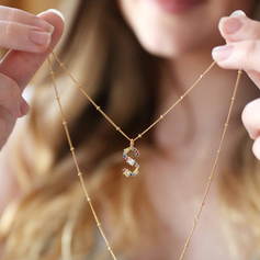 Gemstone initial necklace.png
