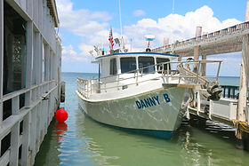 Easy on and off from our dock at go fish south padre